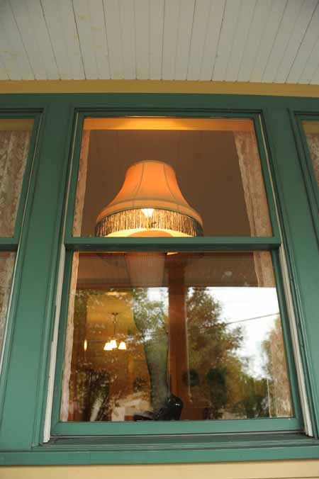 The Leg Lamp shining once again in the window of A Christmas Story House!