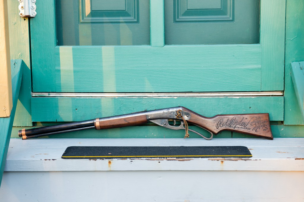 The Red Rider BB Gun used in the movie sits on the back steps of A Christmas Story House and Museum on Monday, Nov. 16, 2015 in Cleveland. The Museum has recently acquired the movie prop and added it to their collection. (Jason Miller/AP Images for A Christmas Story House and Museum)