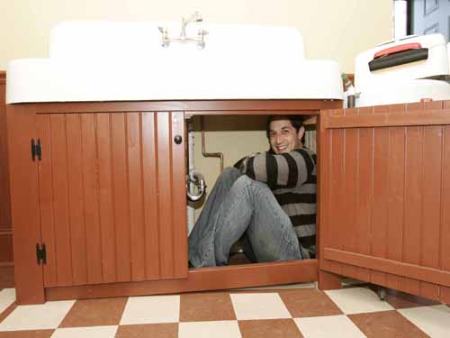 Randy under the sink in A Christmas Story House