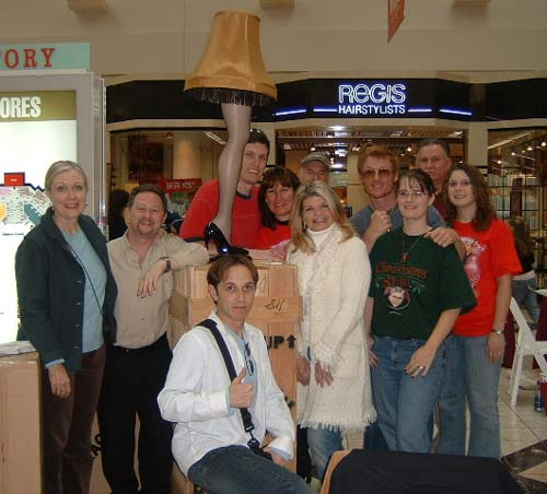 Cast and fundraiser crew gathered around the leg lamp at Strongsville mall