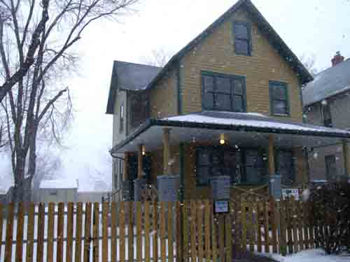 A Christmas Story House while snowing