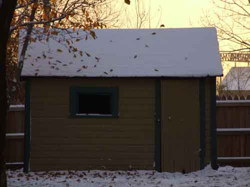 A Christmas Story House shed with snow